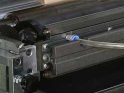 Ink recirculating sealing ink scraper system